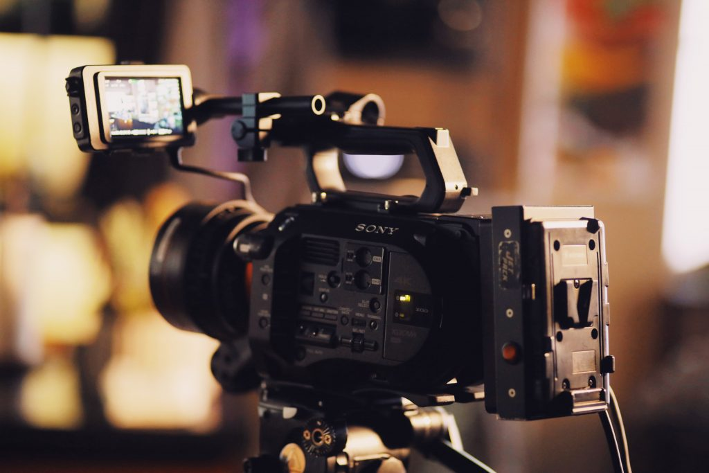 Professional video camera used to shoot home video tours